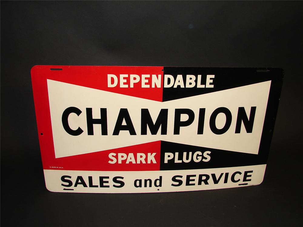 Very unusual N.O.S. late 1950s Champion Spark Plugs Sales and Service tin garage sign. - Front 3/4 - 89364