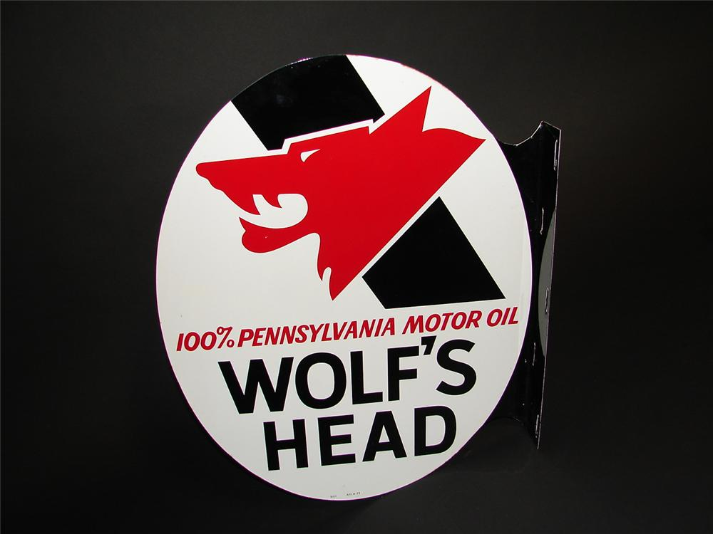 N.O.S. Wolfs Head Motor Oil double-sided tin painted garage flange. - Front 3/4 - 89381
