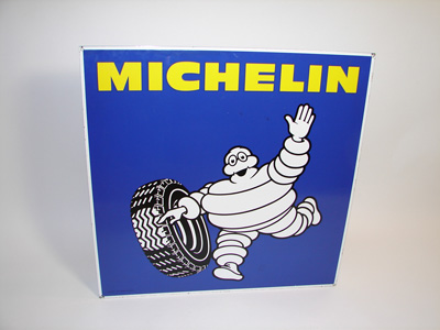 Striking vintage Michelin Tires double-sided porcelain garage sign with Bibedum graphic. - Front 3/4 - 89383