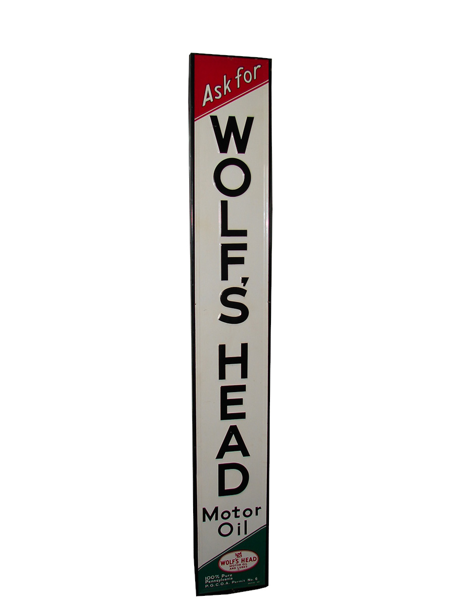 N.O.S. 1959 Wolfs Head Motor Oil single-sided tin painted wood framed vertical garage sign. - Front 3/4 - 89385