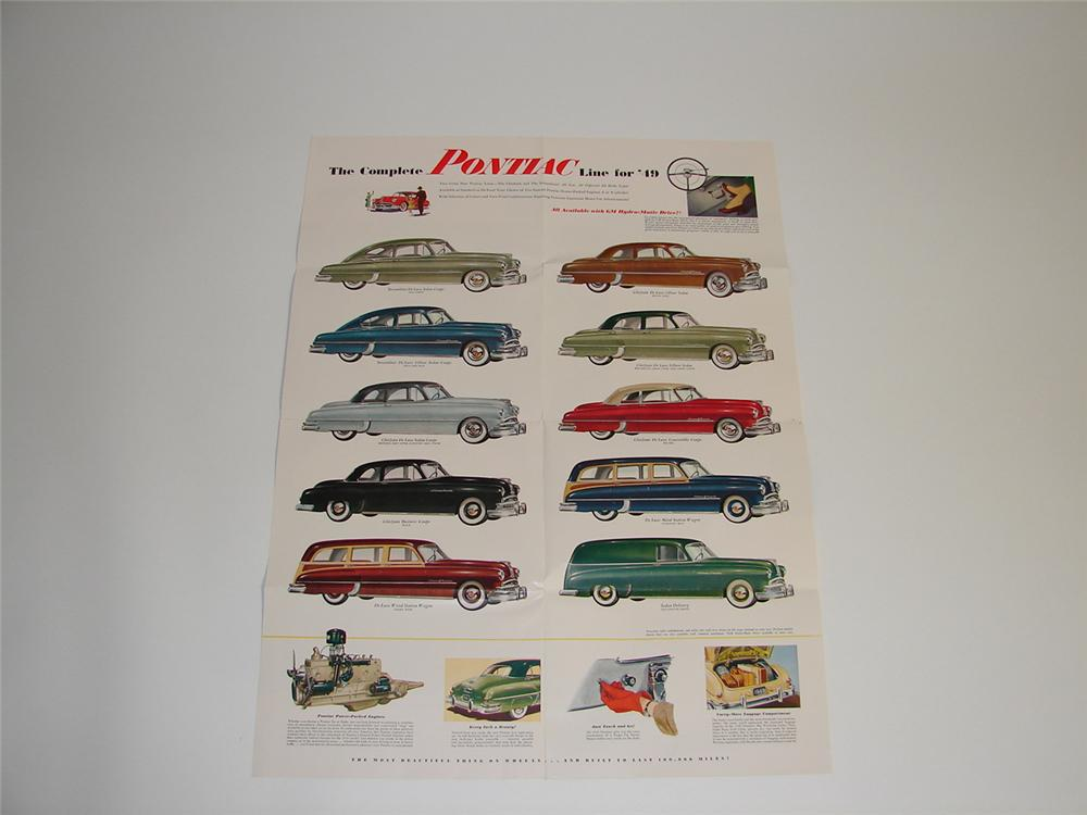 N.O.s. 1949 Pontiac fold out sales brochure. Displays as a poster featuring the entire 1949 line-up. - Front 3/4 - 89404