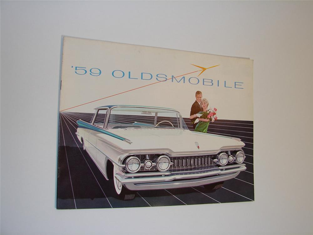 N.O.S. 1959 Oldsmobile 32 page over-sized color sales brochure. - Front 3/4 - 89472