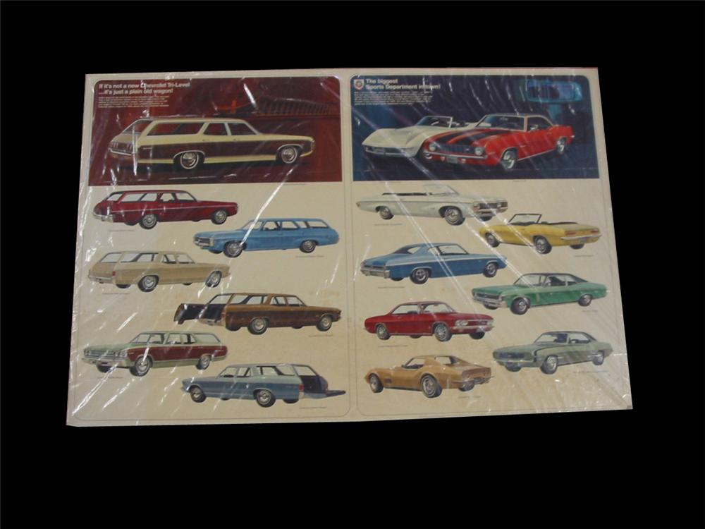 Terrific 1969 Chevrolet Automobiles showroom display cardboard sign featuring all models including Camaro and Corvette. - Front 3/4 - 89536