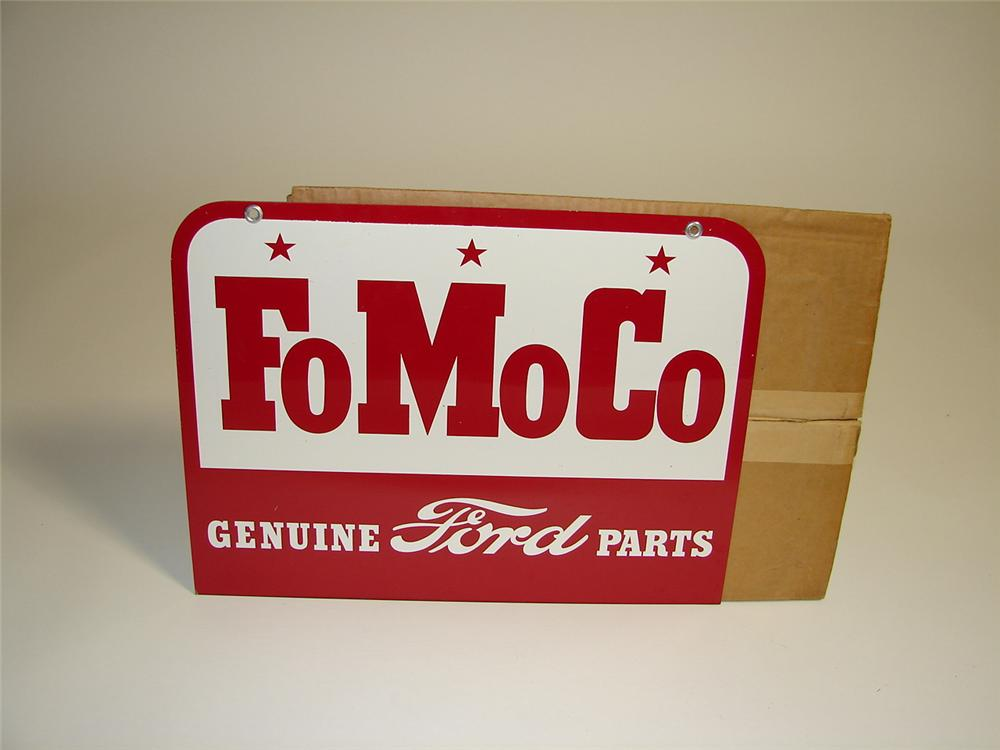 Superlative N.O.S. 1957 Ford FoMoCo Genuine Parts double-sided tin dealership sign still in the original box. - Front 3/4 - 89553