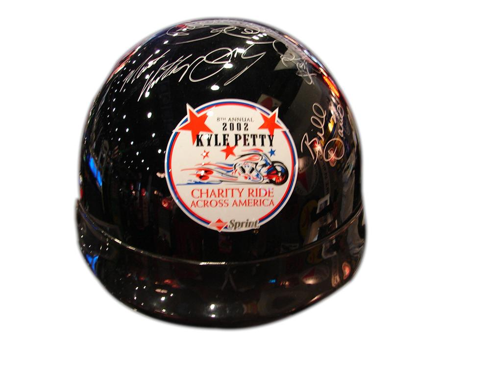 Kyle Petty Charity Ride helmet autographed by Richard Petty, Kyle Petty, Ken Schrader, Terry LaBonte, Harry Gant and others. - Front 3/4 - 90743