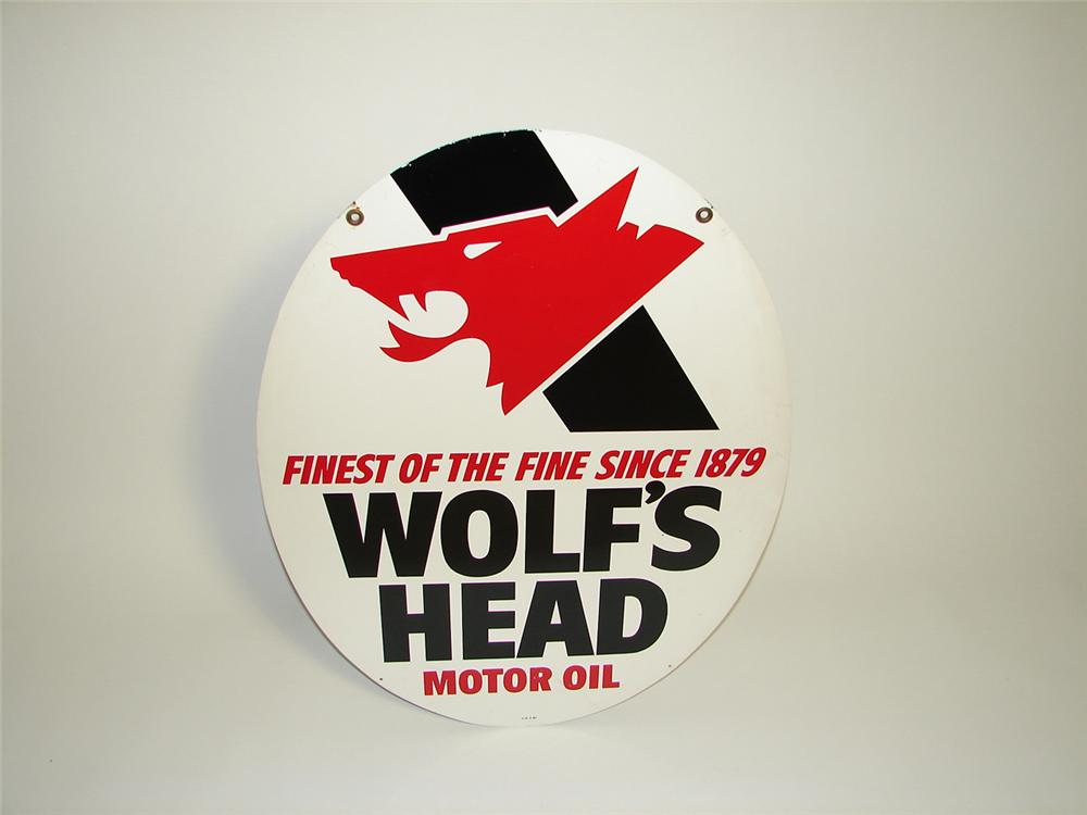 Striking Wolfs Head Motor Oil double-sided die-cut tin painted garage sign with Wolfs Head logo. - Front 3/4 - 91298
