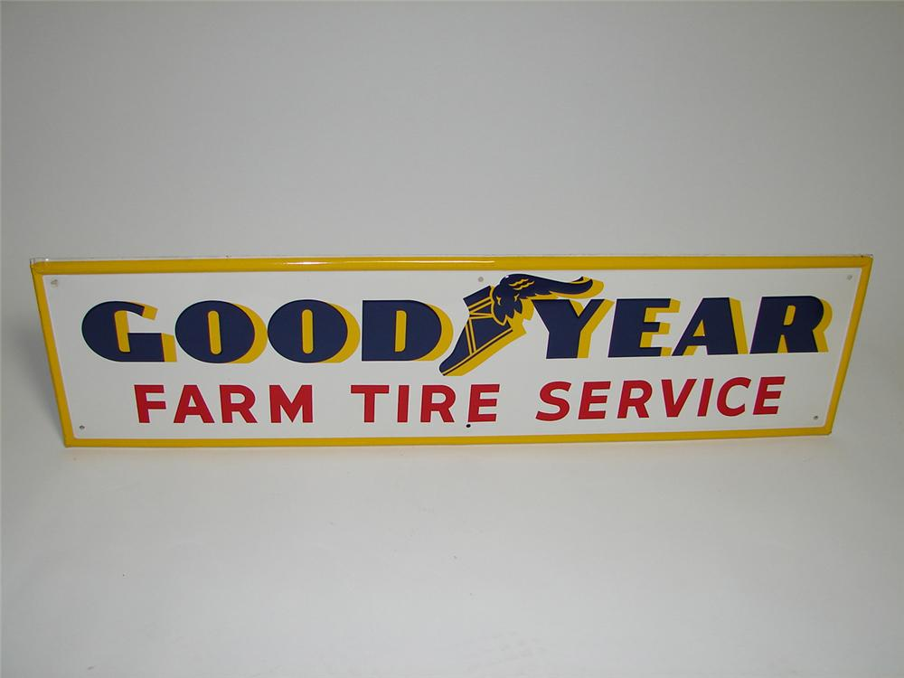 Impressive N.O.S. 1950s GoodYear Tire Service single-sided embossed tin garage sign with winged foot logo. - Front 3/4 - 91307