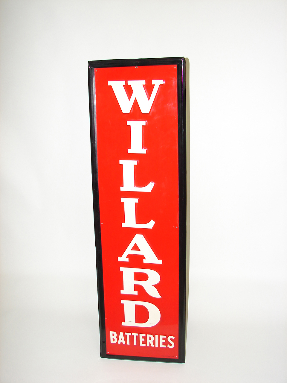 Very clean 1949 Willard Batteries vertical tin garage sign. - Front 3/4 - 91477