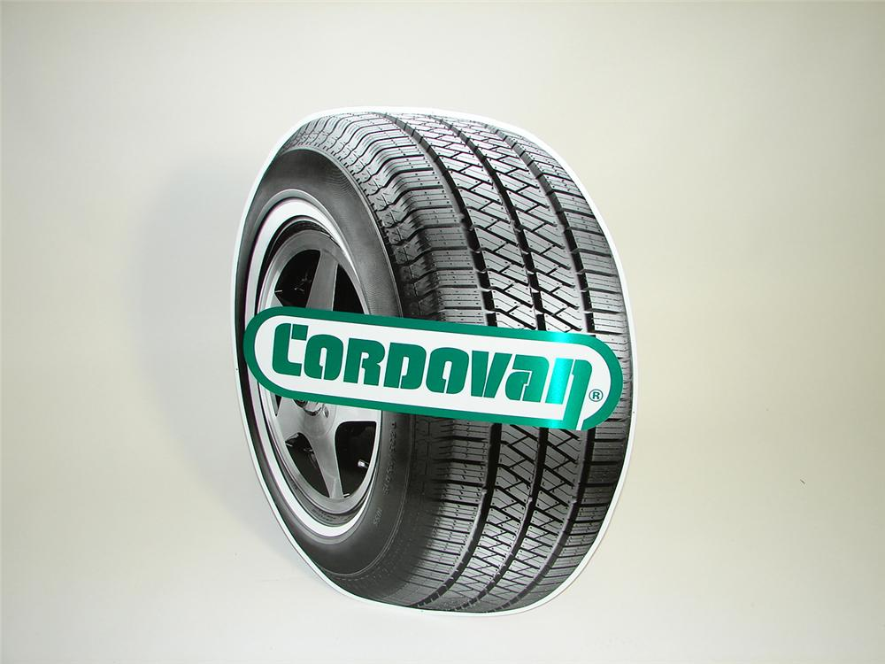 Neat N.O.S. Cordovan Tire die-cut tire-shaped tin sign. - Front 3/4 - 91499
