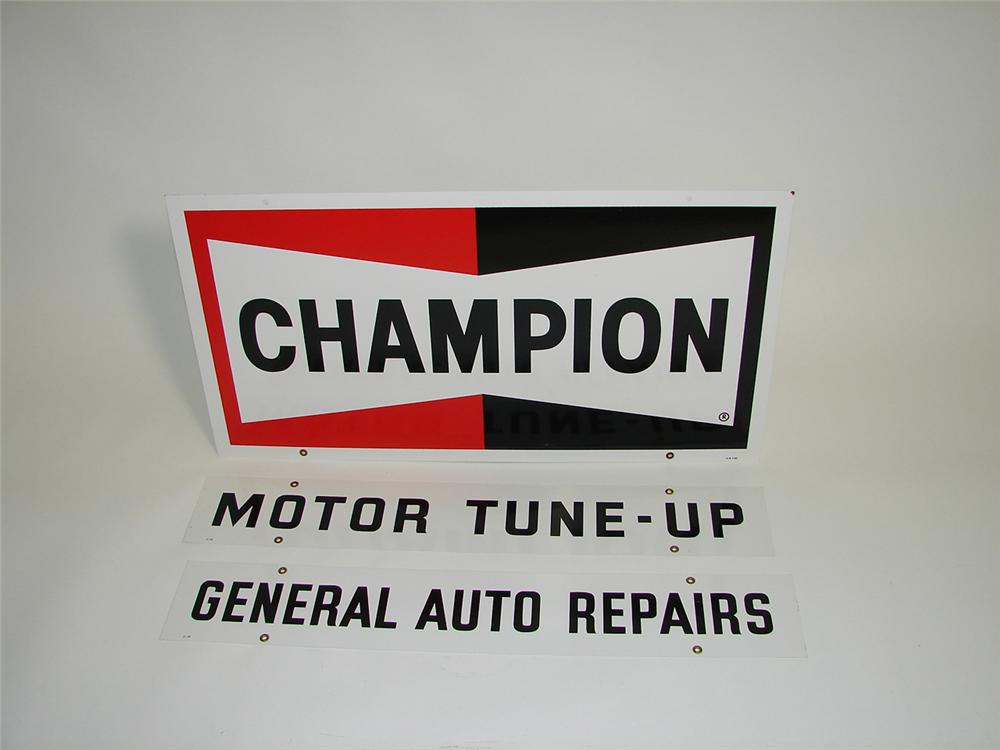 Unusual N.O.S. Champion Spark Plugs double-sided tin garage sign with two add strips. - Front 3/4 - 91504