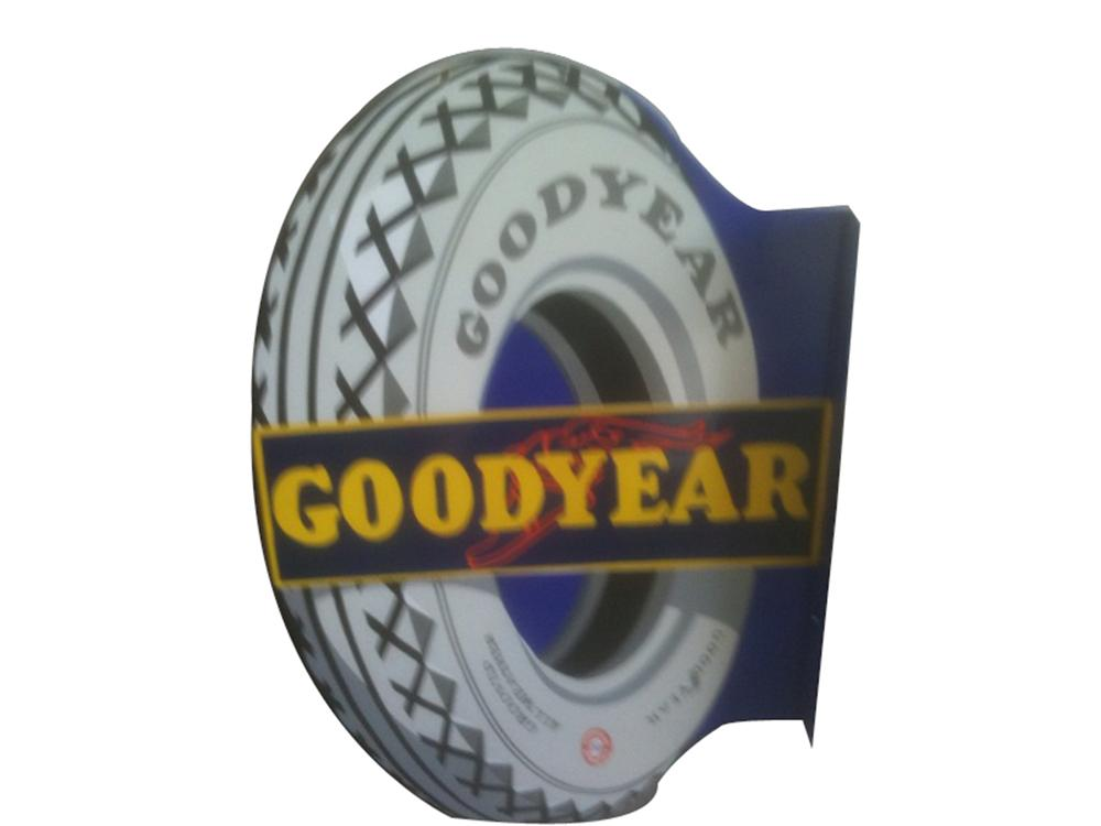 Stunning Goodyear Tires double-sided porcelain tire-shaped garage flange. - Front 3/4 - 91591