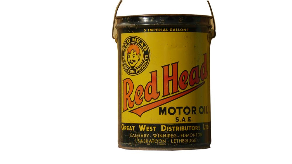 Extremely desirable 1930s Canadian Red Head Motor Oil five gallon can. - Front 3/4 - 91641