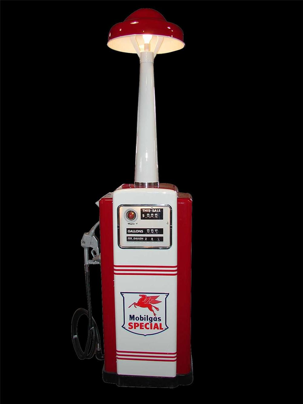 Perfectly restored 1950s Wayne model 100 Mobil Gasoline service station pump with station lighting unit. - Front 3/4 - 91652