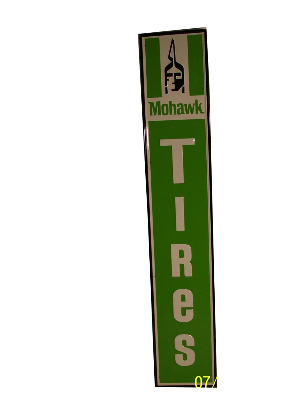 Very nice N.O.S. 1960s Mowawk Tires vertical tin garage sign with indian logo. - Front 3/4 - 91664