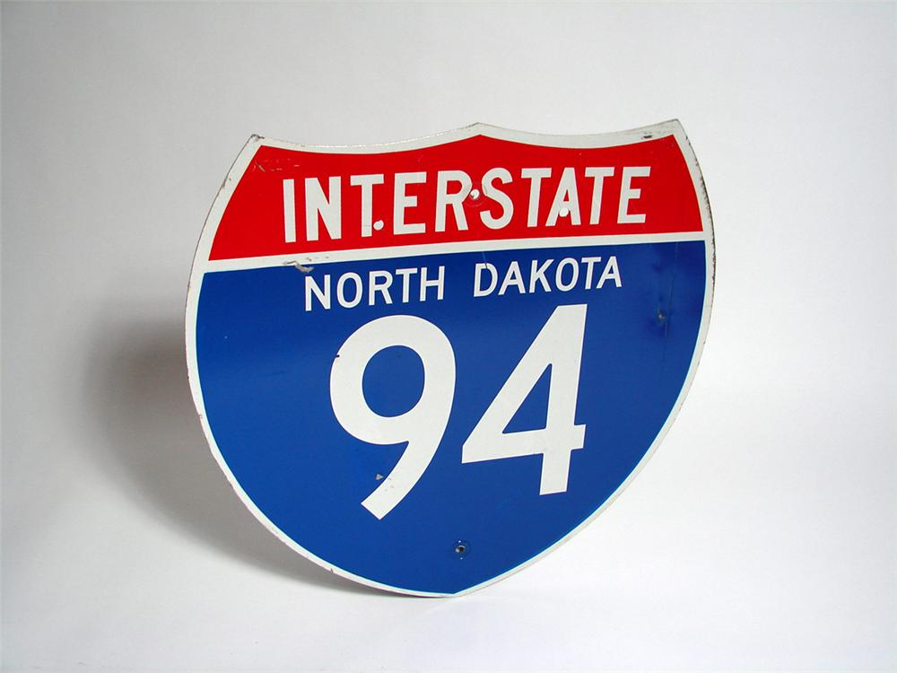 Lightly used North Dakota Interstate 94 Highway road sign. - Front 3/4 - 93725