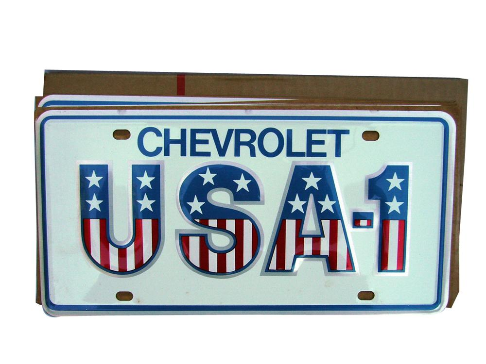 N.O.S. box of six Chevrolet USA-1 showroom license plates. - Front 3/4 - 93949