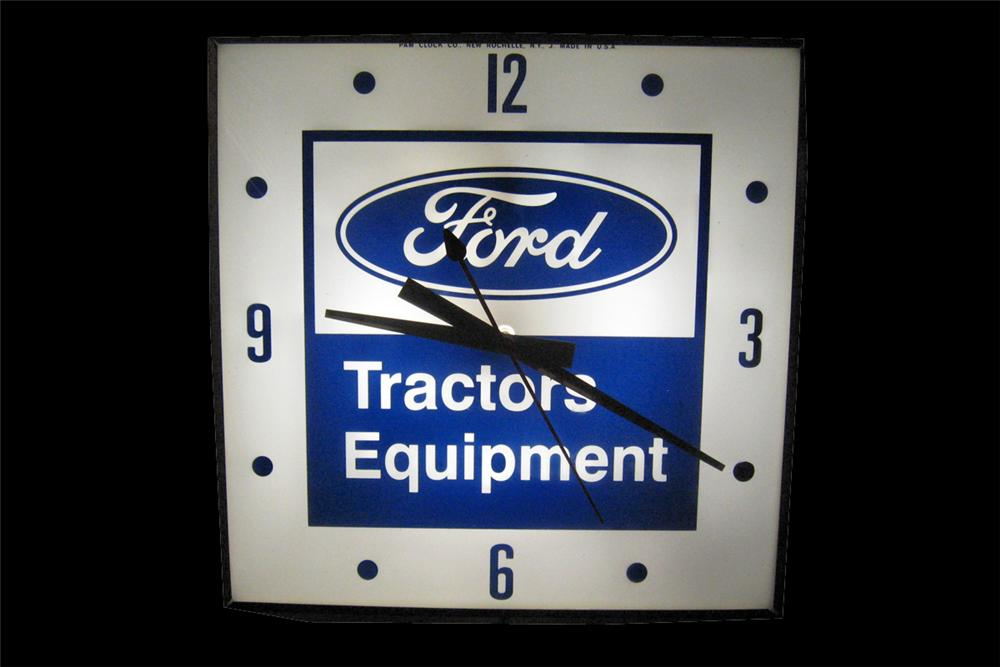 Very clean late 1950s Ford Tractors and Equipment glass faced light up dealership clock by Pam. - Front 3/4 - 94013