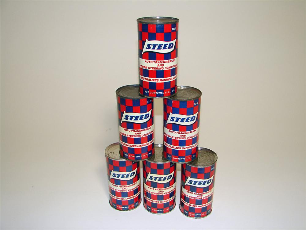 Lot of six N.O.S. 1950s-60s Steed Transmission and Power Steering Conditioner tins with checkered flag motif. - Front 3/4 - 97128