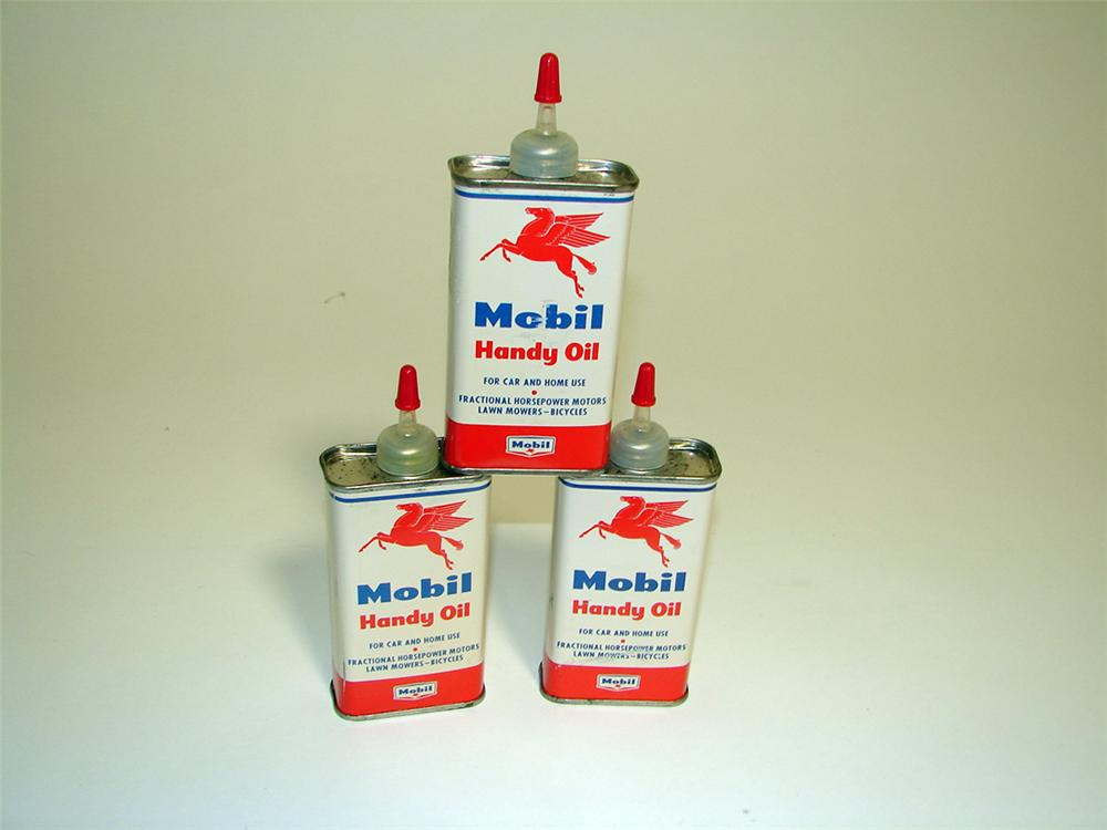 Choice lot of three N.O.S. 1950s Mobil four ounce Handy Oilers still full and unused. - Front 3/4 - 97129