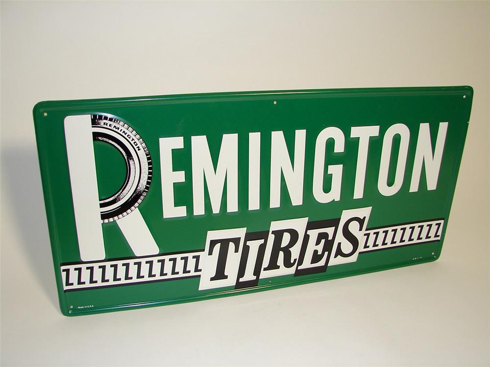 Very nice N.O.S. Remington Tires single-sided tin embossed garage sign. - Front 3/4 - 97152