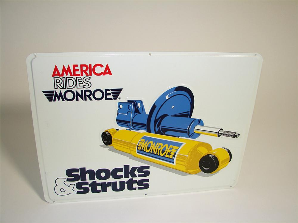 Very clean N.O.S. Monroe Shock Absorbers single-sided tin painted garage sign with Shocks & Struts graphic. - Front 3/4 - 97161