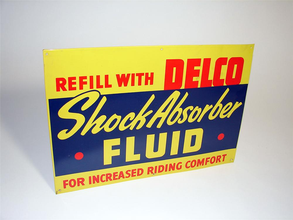 Choice 1950s GM Delco Shock Absorber Fluid single-sided tin painted dealership sign. - Front 3/4 - 97268