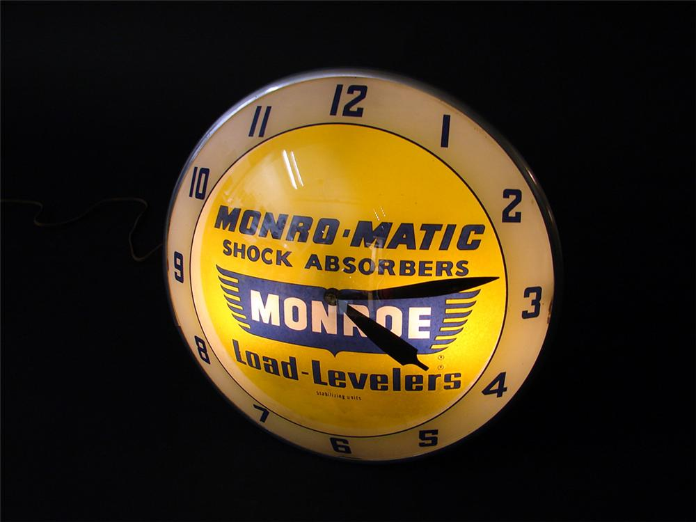 Very clean 1950s Monroe Shock Absorbers double-bubble light-up garage clock. Lights well. - Front 3/4 - 97276