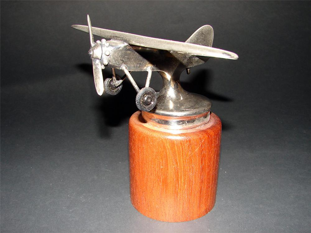 Stunning 1930s Spirit of St. Louis Airplane hood mascot displayed on custom base. - Front 3/4 - 97302