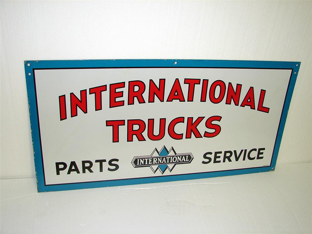Very clean 1940s-50s International Trucks double-sided porcelain dealership sign. - Front 3/4 - 97316