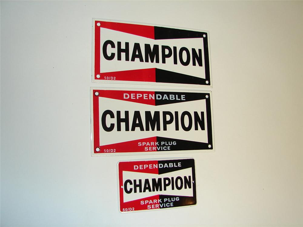 Set of three N.O.S. Champion Spark Plugs porcelain garage signs. - Front 3/4 - 97343