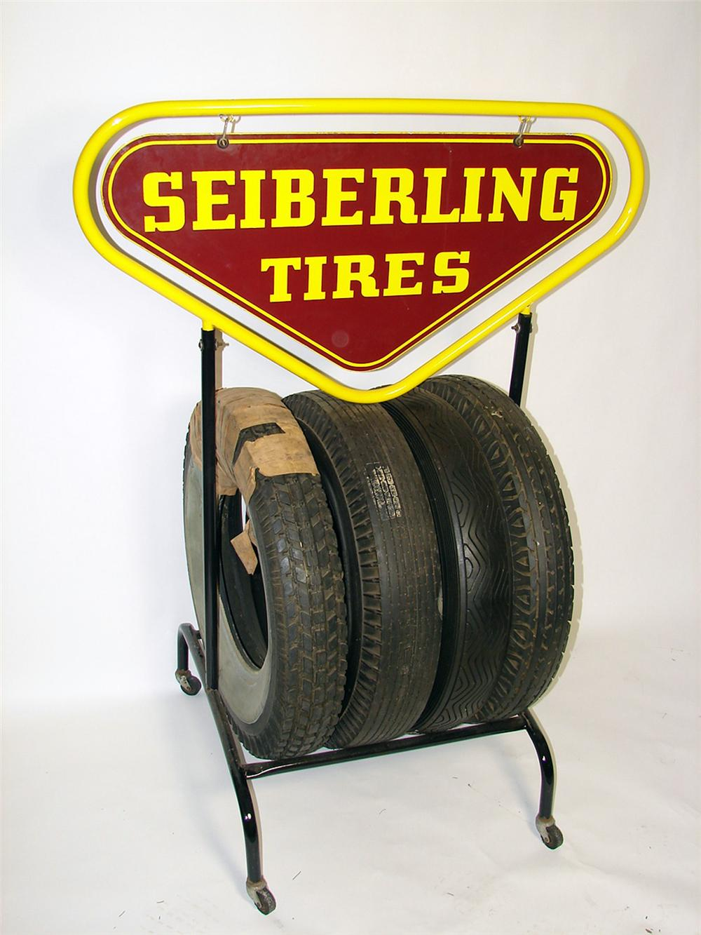 Simply superb 1930s-40s Sieberling Tires service station tire rack with porcelain sign and N.O.S. tires. - Front 3/4 - 97471