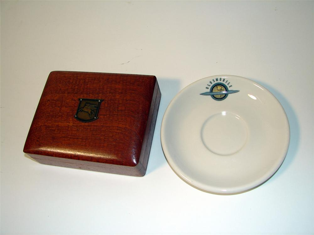 Lot consisting of a 1930s Mobil Oil cigar/card box and a 1940s Oldsmobile saucer by Syracuse. - Front 3/4 - 97592