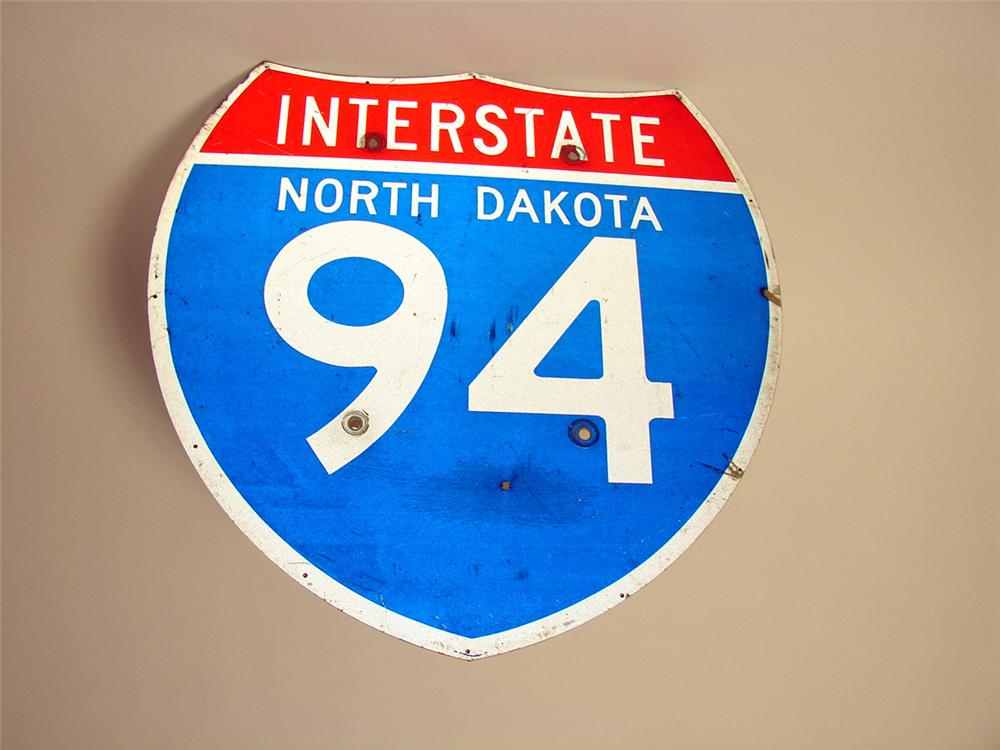 Lightly used North Dakota Interstate 94 highway metal sign. - Front 3/4 - 97595