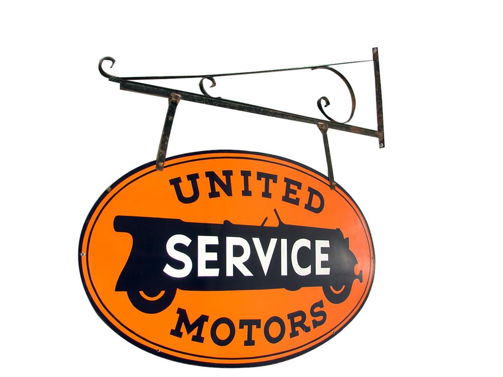 Rare 1930s-40s United Service Motors (GM) double-sided porcelain dealership sign with original hanging bracket. - Front 3/4 - 97642