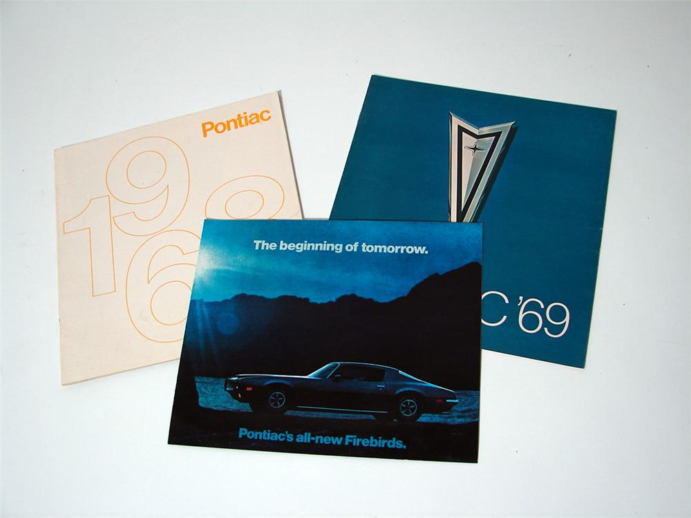 Lot of three Pontiac showroom sales brochures for 1968,1969, and 1970. - Front 3/4 - 97644
