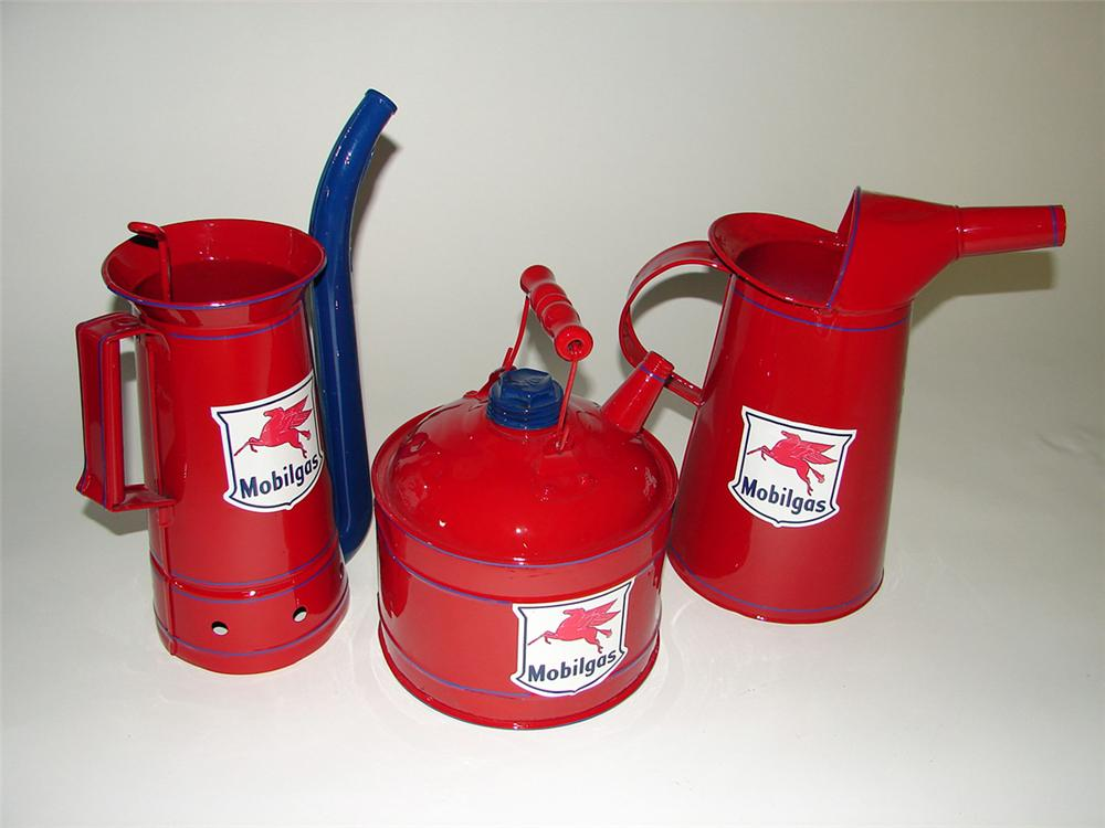 Lot of three circa 1930s-40s Mobil Oil service department oil/gas cans. - Front 3/4 - 97680