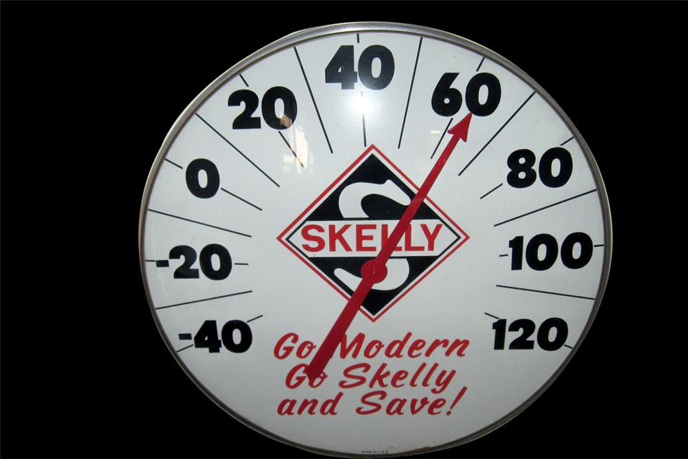 Sharp 1950s Skelly Gasoline over-sized service station dial style glass faced thermometer. - Front 3/4 - 97810