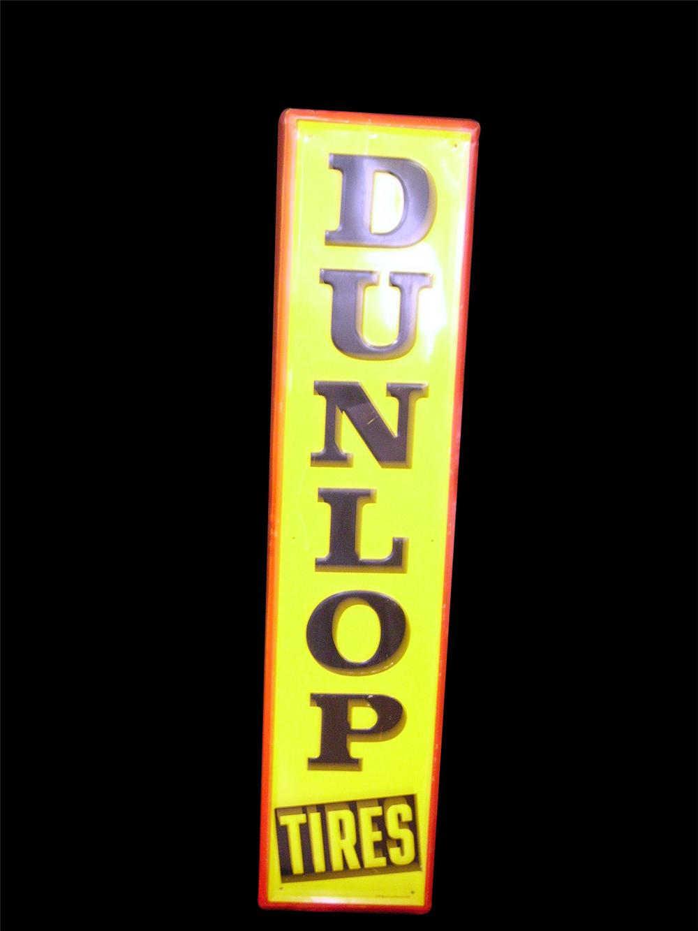 N.O.S. 1956 Dunlop Tires single-sided tin embossed garage sign. - Front 3/4 - 97862
