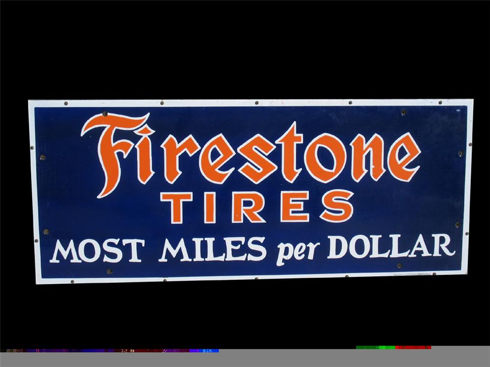 "Absolutely gorgeous 1930s Firestone Tires ""Most Miles Per Dollar"" single-sided porcelain garage sign. - Front 3/4 - 97915"