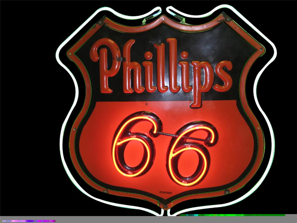Circa 1957 Phillips 66 double-sided porcelain neon service station shield shaped hanging sign. - Front 3/4 - 97928