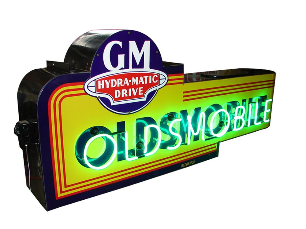 "Stellar late 1940s-50s Oldsmobile double-sided porcelain neon sign featuring the ""GM Hydra-Matic Drive"" logo. - Front 3/4 - 97940"