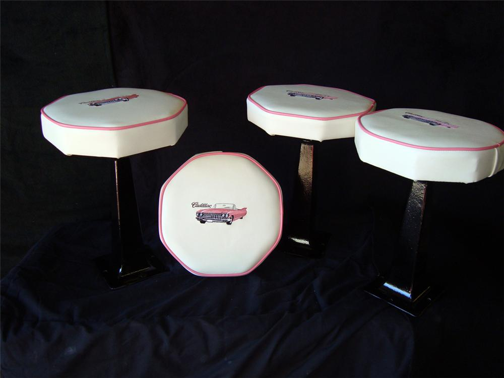 Set of four restored cast iron bar stools which have been reupholstered with a 1959 Cadillac on top. - Front 3/4 - 98028