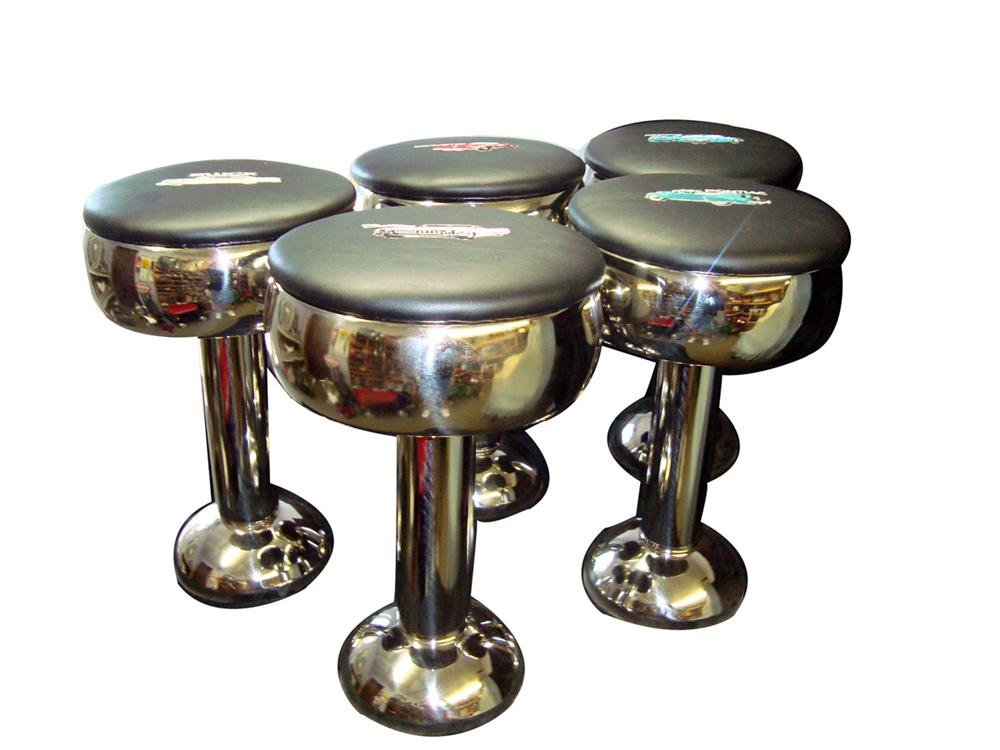Lot of five 1940s-50s diner stools all re-chromed and upholstered with various vintage car embroidery. - Front 3/4 - 98036