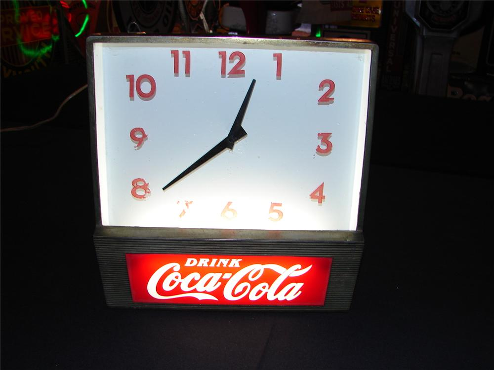 Addendum Item - 1950s Coca-Cola glass faced light-up diner clock with fishtail logo. - Front 3/4 - 99611