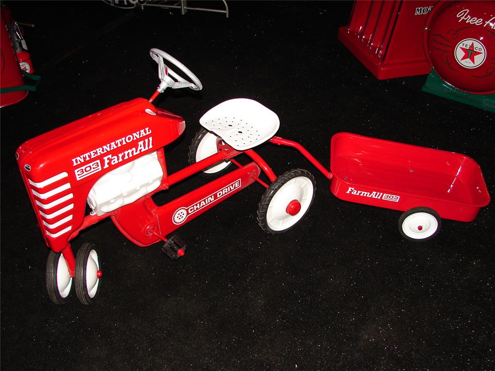 Addendum Item - Wonderfully restored 1950s Farmall 303 childs pedal tractor with wagon. - Front 3/4 - 99615