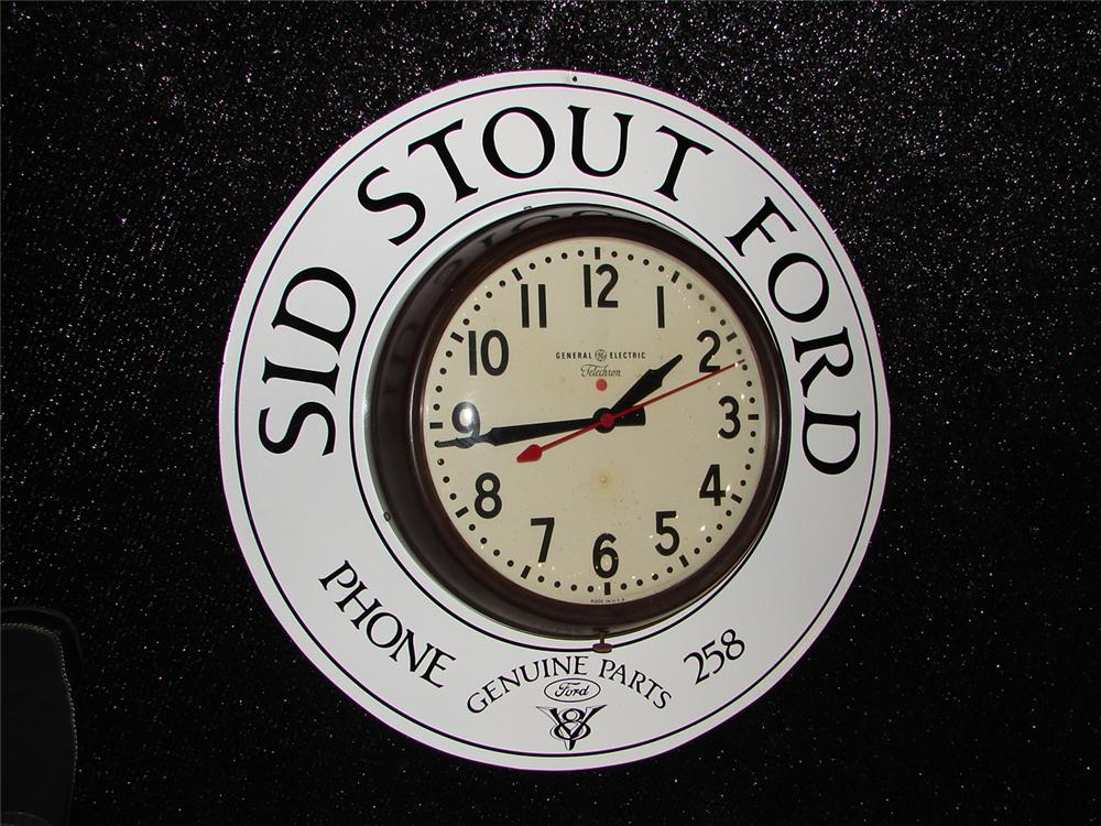 Addendum Item - Restored 1930s Sid Stout Ford G.E. showroom clock. - Front 3/4 - 99620