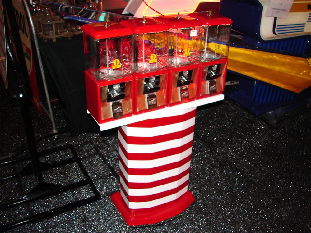 Addendum Item - Nice set of four 1960s North Western peanut-gum machines on stand. - Front 3/4 - 99627