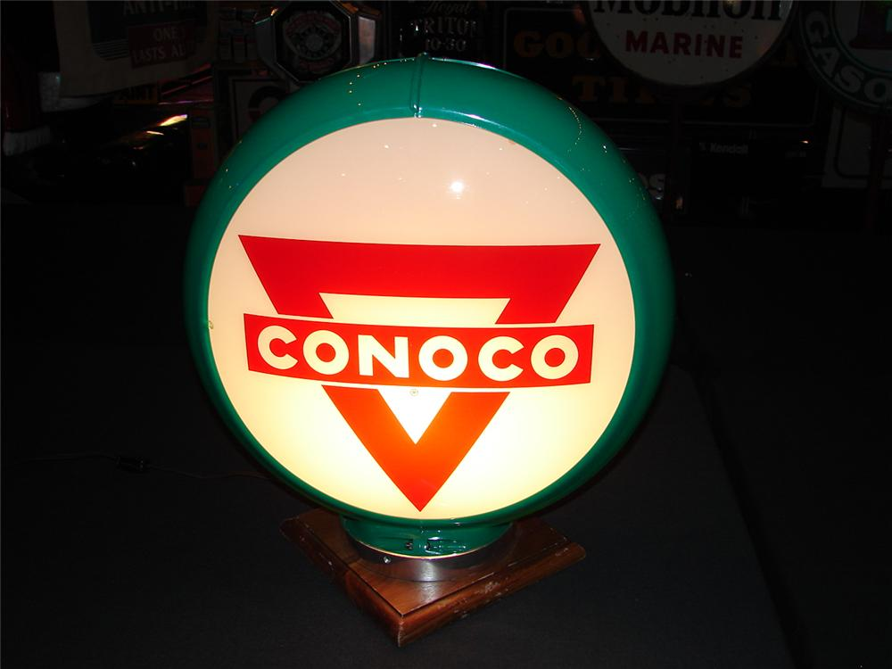 Addendum Item - Circa 1949 Conoco Gasoline green plastic bodied Capco globe with glass lenses. Condition: 9.25-9.5 - Front 3/4 - 99642