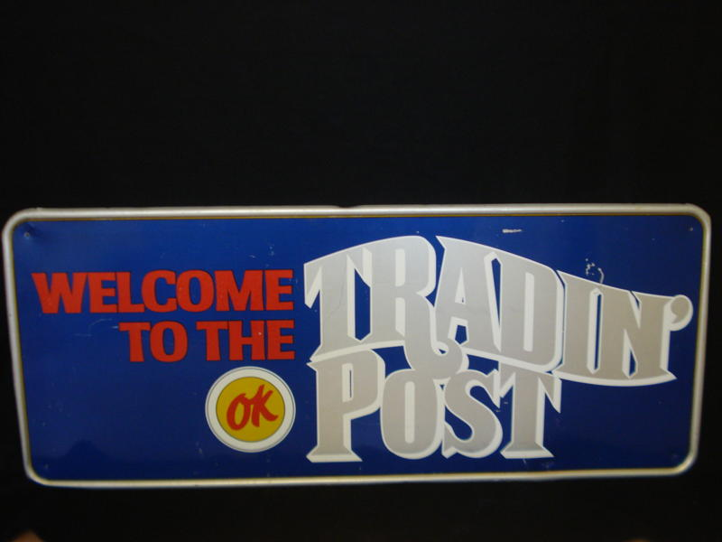 "Addendum Item - Hard to find 1960s Chevrolet OK Used Cars ""Tradin Post"" single-sided tin painted dealership sign. - Front 3/4 - 99655"