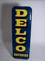 Highly desirable 1950s Delco Batteries vertical tin garage sign. - Front 3/4 - 116933